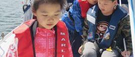 Chinese children moving around the boat